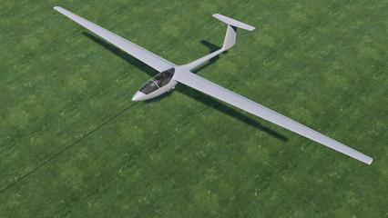 Segelflugzeug startet auf einer Wiese