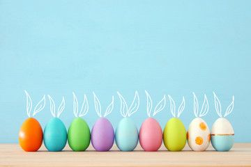 Top view of easter colorful eggs over blue background Wall mural