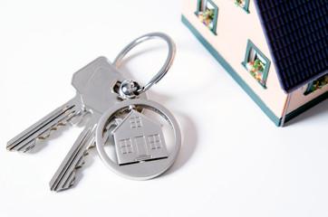 House key on a house shaped pendant.