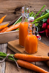 Freshly squeezed carrot juice and organic raw vegetables