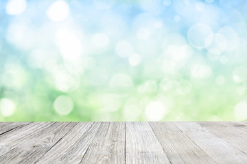 Wooden deck with blurred meadow background