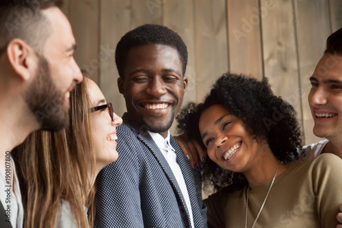 happy diverse black and white people group with smiling faces