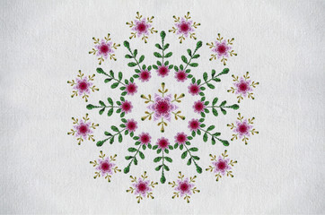 Embroidered satin stitch pattern with pink cloves,red flowers and leaves