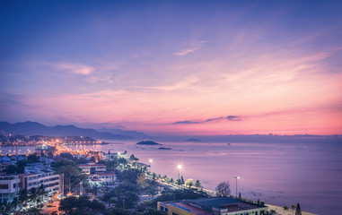 Vietnam, Nha Trang. May 8, 2015. Beautiful night landscape of the city and sea. The dawn dawned beyond the horizon.