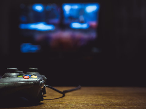 video game joystick gamepad on the table in front of tv