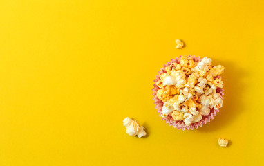 Popcorn on a yellow background. Minimal gallery. Flat lay. Copy space.