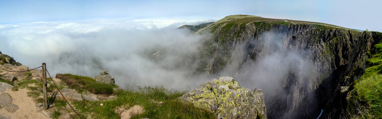 Clouds creeping into the valley of Sniezne Kotly