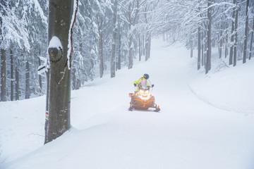 Man on snowmobile, sport photo, wonderful winter nature