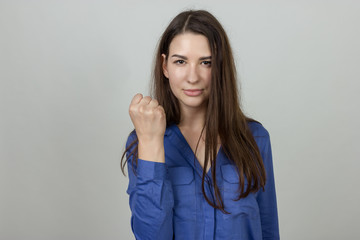 Woman  shows a fist