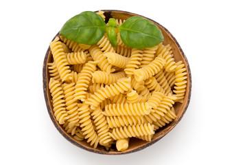 Uncooked fusilli pasta isolated white background.