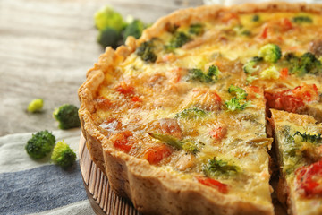 Tasty broccoli quiche on table, closeup
