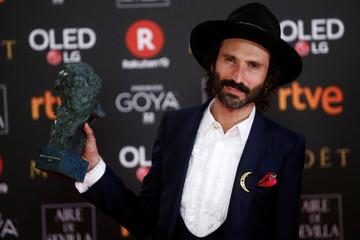 Singer Leiva, who won the Best Original Song award, holds up his trophy during the Spanish Film Academy's Goya Awards ceremony in Madrid