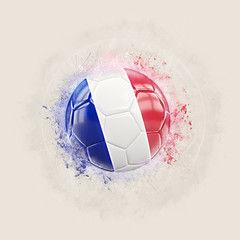Grunge football with flag of france