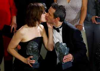 Nathalie Poza, who won the Best Actress Award, kisses Gustavo Salmeron, who won the Best Documentary Film award, during the Spanish Film Academy's Goya Awards ceremony in Madrid