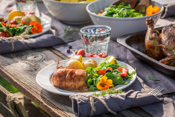 Healthy dinner with salad and chicken served in the countryside