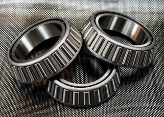 3 automotive tapered roller bearings on carbon fiber.
