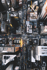 Overhead view of cityscape with vehicles moving on street
