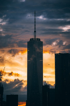 View of One World Trade Center against cloudy sky at sunset