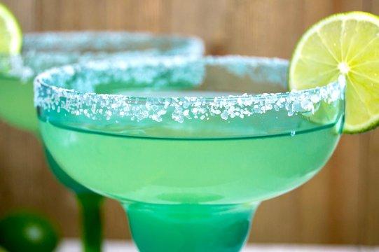 Margaritas in festive green glasses