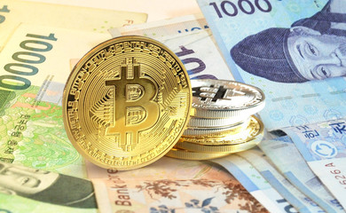Bitcoin coins on Korean Won banknote, Cryptocurrency concept photo