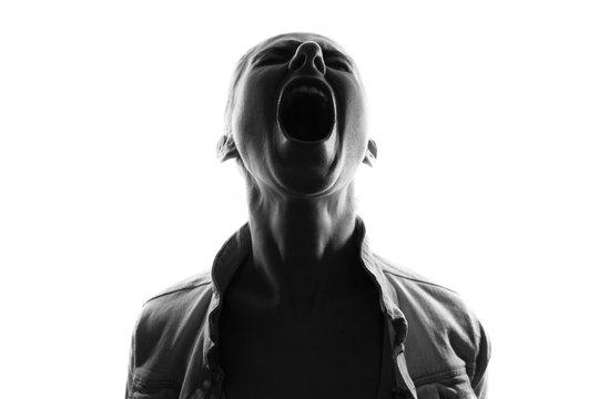 Screaming woman silhouette,back lit light