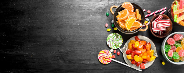 Different sweet candy, jelly and candied in a bowl. Wall mural