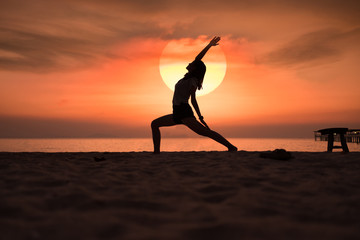 Yoga in the sunset beach