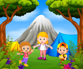 Children camping out in the park with mountain scene