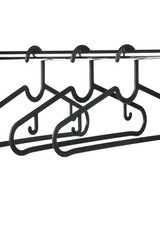 Three empty coat / clothes hangers on a clothes rail with a white background. Potential copy space above and below hangers.