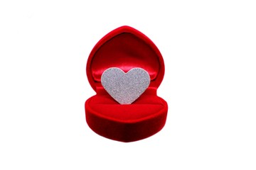 Silver glitter heart in wedding ring box. Valentines day present concept.