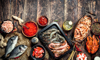 Wall Mural - Different seafood with shrimps and red caviar.