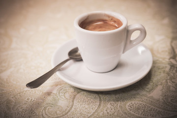 Small white cup of espresso coffee, vintage