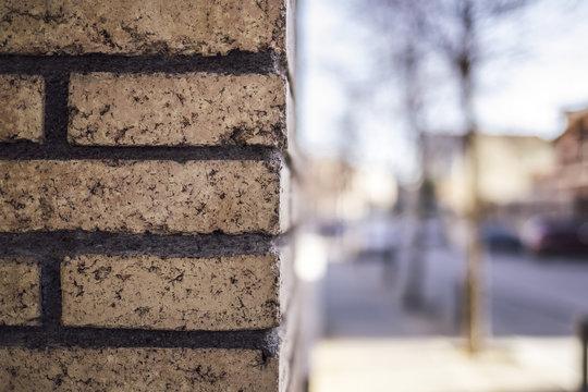 Brick wall rock corner wall on a blurred street