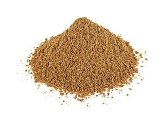 Heap of raw organic coriander powder on a white background