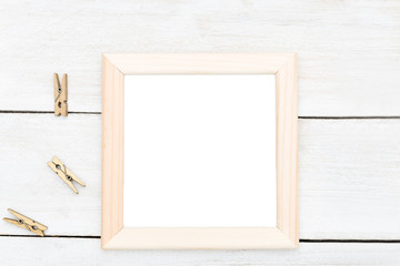 Wooden frame and wooden clothespins, Scandinavian style. Mock up