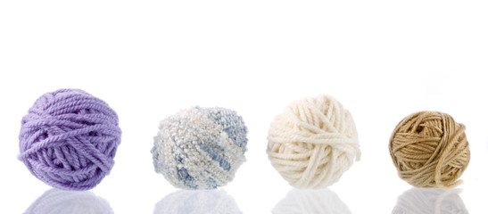 Yarn for handwork and knitting. Set on a white background with reflection.