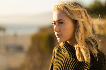 Young caucasian woman looking far away thinking