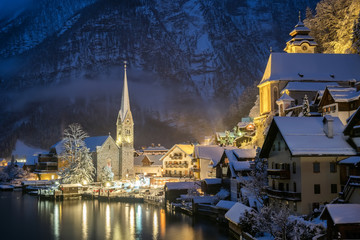 Poster Bleu nuit Hallstat village in the Austria at the evening time. Beautiful village in the mountain valley near lake