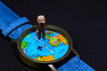 Old man with backpack and world map watches. Around world travel photo banner.
