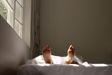 the feet of a person who is sleeping
