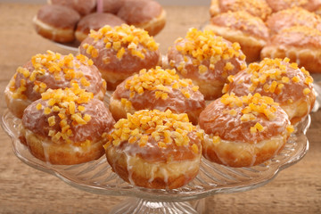 Traditional Polish donuts with filling and orange
