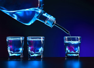 Vodka is poured into a glass .