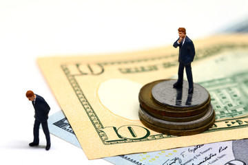 Winning and losing businessmen figurines. Miniature model. Cash banknotes and coins.