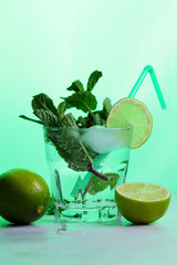 Cocktail with lime, lemon and mint, cool drink in toning, transparent drink with ice, isolated, toning, pop art drink, art