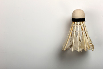 Set shuttlecock on grey, feather volant for badminton game, close-up. Copyspace, textspace.