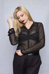 Beautiful sexy pretty girl wear black suit blouse and pants lady boss business woman skin tan long blonde hair party style fashion cloches studio grey background.
