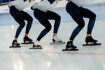 warm up team of male skaters in competition speed skating