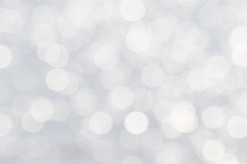 Soft de-focused shiny white bokeh abstract background