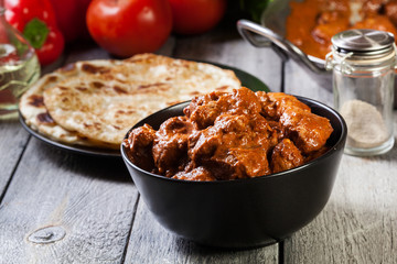 Chicken tikka masala served with bread naan