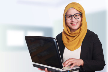 Muslim Businesswoman with Laptop